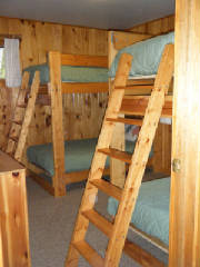 Cabin #15's bunk bedroom with dresser and closet