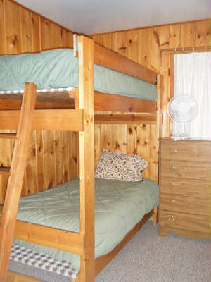 Cabin #14's 4th Bedroom has 2 sets of twin size bunk beds.  (2 top bunks, 2 bottom bunks)