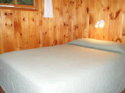 Cabin #14 offers 2 queen bedrooms, 1 king bedroom, and 1 bedroom with 2 sets of bunk beds.  Linens and blankets provided.