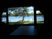 Cabin 3 lakeside picture window is located in the dining area.  What a view!