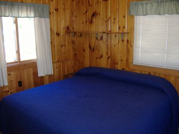 King Bedroom in Cabin #7.  Built in dresser & closet to the right of the bed.