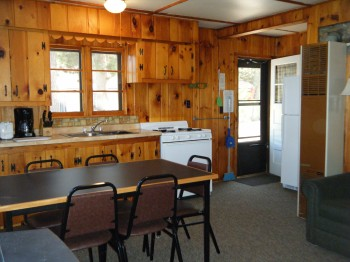 Cabin 3 kitchen is full stocked with pans/dishes/silverware and full size appliances.  Microwave & automatic coffee pot.