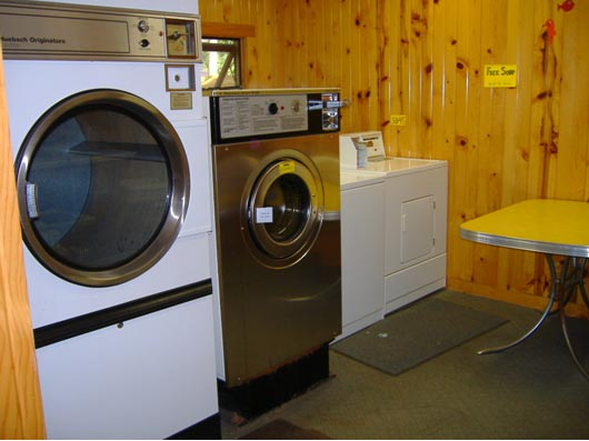 Coin Operated Laundry facility,  Triple Loader Washing Machine & Dryer,  Plus Regular Household size Washer & Dryer.  Non-phosphorus (environmentally friendly) Laundry Soap Available for our guests staying at Towering Pines Resort.